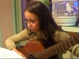 Maeva ,11,plays the guitar/ Maeva joue de la guitare