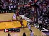 Dwyane Wade picks up the errant pass and throws down a dunk