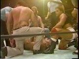 John Studd attacks Andre with shears