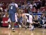 Earl Boykins drives to the basket but Dwight Howard blocks h