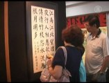 Chinese Artists Promote Calligraphy and Paintings