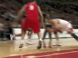 Derrick Rose passes between Javis Hayes' legs for the give a