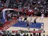 Eric Gordon drives down the lane and goes over Tim Duncan fo