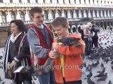 Italy travel: Venice's St. Mark's Square feeding pigeons, pa