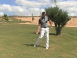 Golf Tips tv: How to hit from a downhill lie
