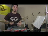 dog playing drums online lessons