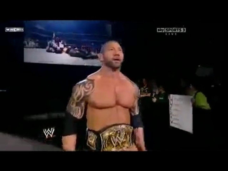 Batista gives Cena a cheap shot