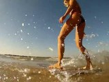 Skimboard : Beautiful girl skimboarding for fun