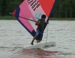 Freestyle windsurfing - back-to-front, stern-first railride