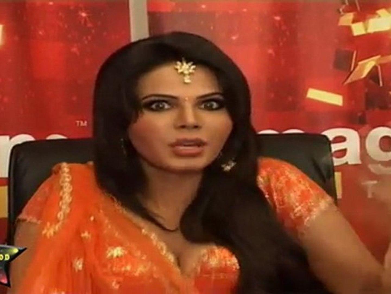 Sexy Rakhi Sawant In Sexy Orange Lahanga Choli Shows Her Small Cleavage