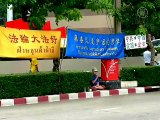 Elderly Woman Protesting Persecution of Falun Gong is Attacked