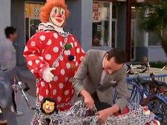 Pee wee Herman locking his bike
