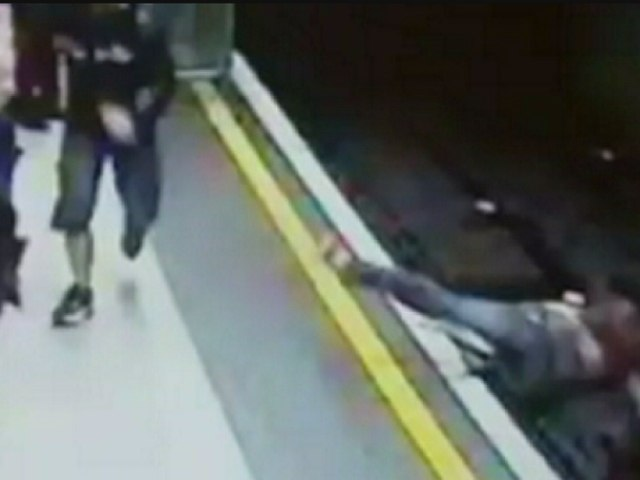 CCTV: Woman pushed onto Tube tracks at Leicester Square