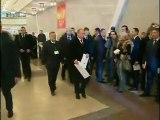 Vladimir Putin casts his ballot