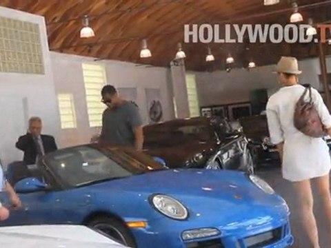 Michael Strahan and Nicole Murphy go Porsche shopping.