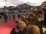 Kanye West steps out with Kim Kardashian for Cannes premiere.
