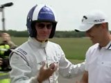 David Coulthard catches golf ball in a car