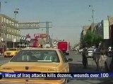Dozens killed in wave of Iraq attacks kills at least 20