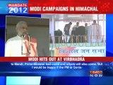 Modi takes on PM, Sonia
