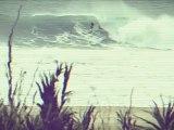 Kelly Slater and Joel Parkinson surfing big waves in Praia do Norte Nazare