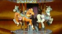 Lutèce Créations, spécialiste des boîtes à musique et des automates présente un carrousel musical miniature de sa collection de manèges musicaux animés (carrousels, grandes roues et autres manèges miniatures).