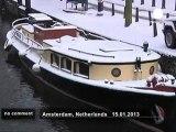 Paysage hivernal de carte postale à Amsterdam - no comment