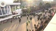 Obamas walk parade route, view inaugural parade