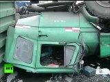 Close Shave: Truck overturns, misses motorcyclist by inches