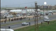 Protesters clash with police at Syrian refugee camp in...