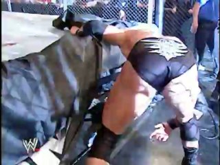 Brock Lesnar vs The Undertaker (No Mercy 2002, Hell in a Cell match, WWE Championship)