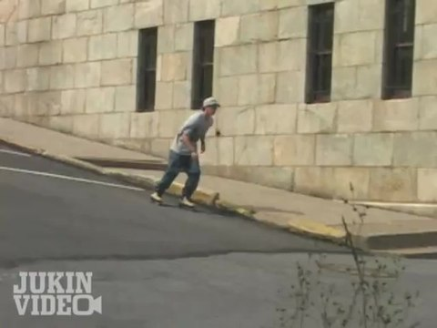 Skater jumps from roof to pavement