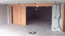 stores et fermetures du prarion - porte de garage sectionnelle latérale 1
