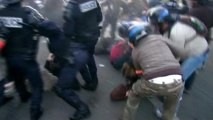French demonstrators scuffle with police