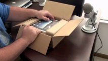 Apple iPad Unboxing! I also unbox the official iPad case from Apple.