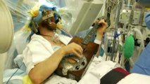 Patient plays guitar during brain surgery