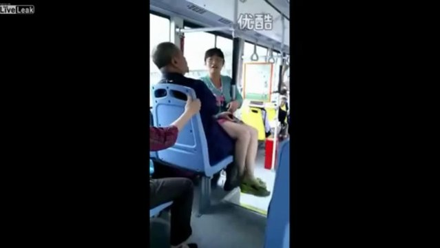 Woman sits on man's laps after losing fight over seat on bus