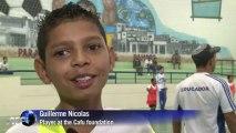 Brazilian footballer Cafu helps favela kids