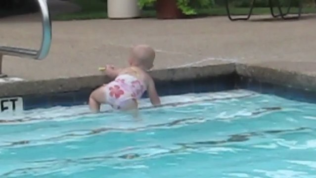 Toddler swims solo in the pool