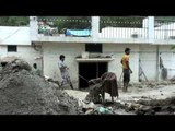 Localites rebuilding their houses after Uttarakhand flood