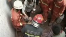 Rescuers free Chinese boy trapped between two walls