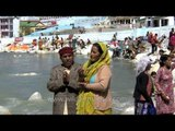 Couple prays at the banks of River Ganges at Gangotri Dham