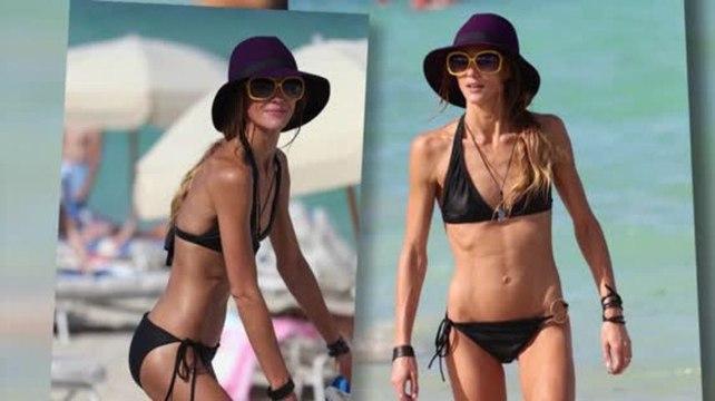 Sharni Vinson Frolics on the Beach in a Tiny Black Bikini