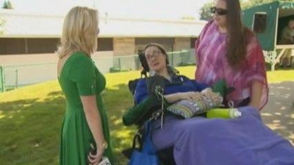 Paralyzed woman controls robot arm