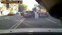 Motorcyclist Crashes Into Open Door - Video