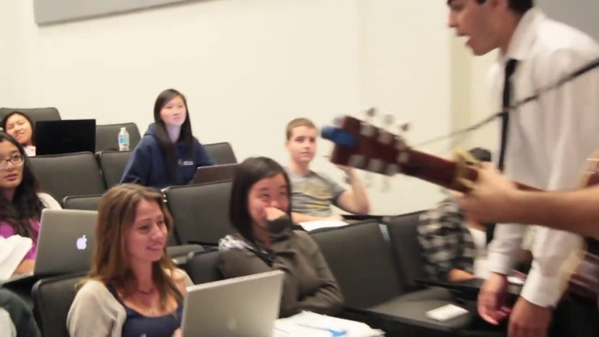 Serenading Random Girls During University Lecture, With A Guitar and Flowers