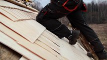 893_Roofer_wearing_work_clothes_cedar_wooden_shingle_shake