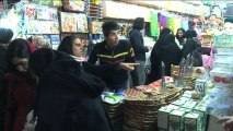 Iranians desperate for sanctions relief cheer nuclear deal