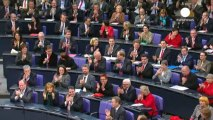 Smiles from Angela Merkel but she faces a tough road ahead