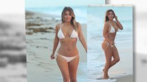 Kim Kardashian va a la playa en biquini blanco