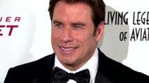 John Travolta écorche le nom d'Idina Menzel en la présentant aux Oscars
